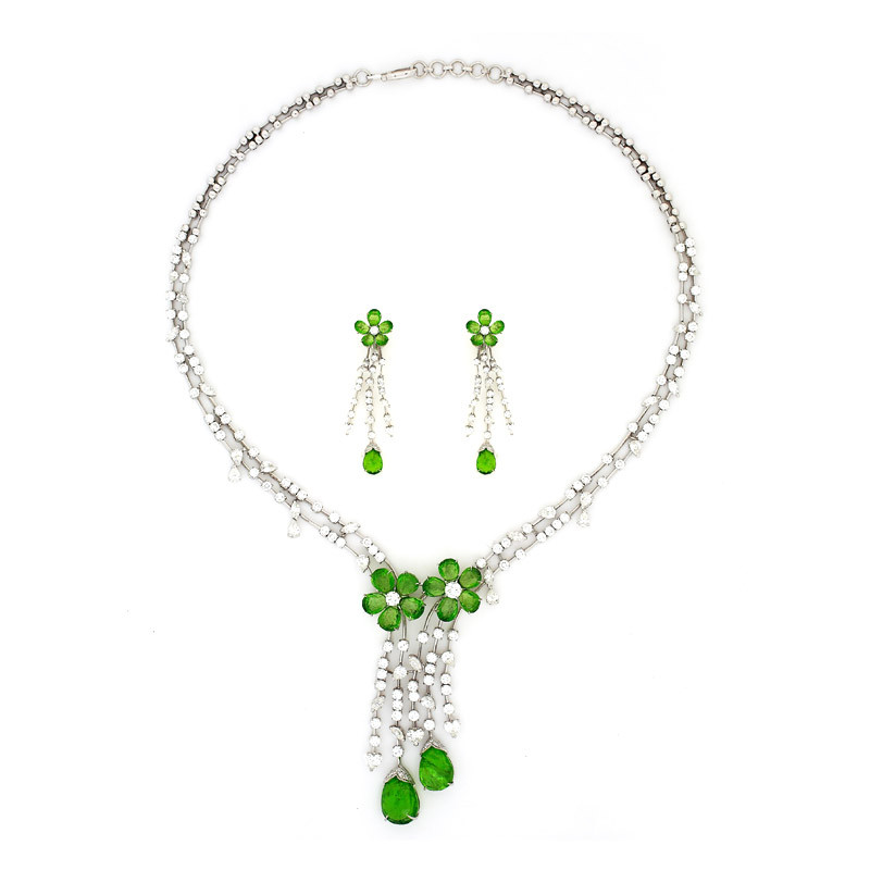 Shimmering Diamond with peridot flower and vivid oval peridot below