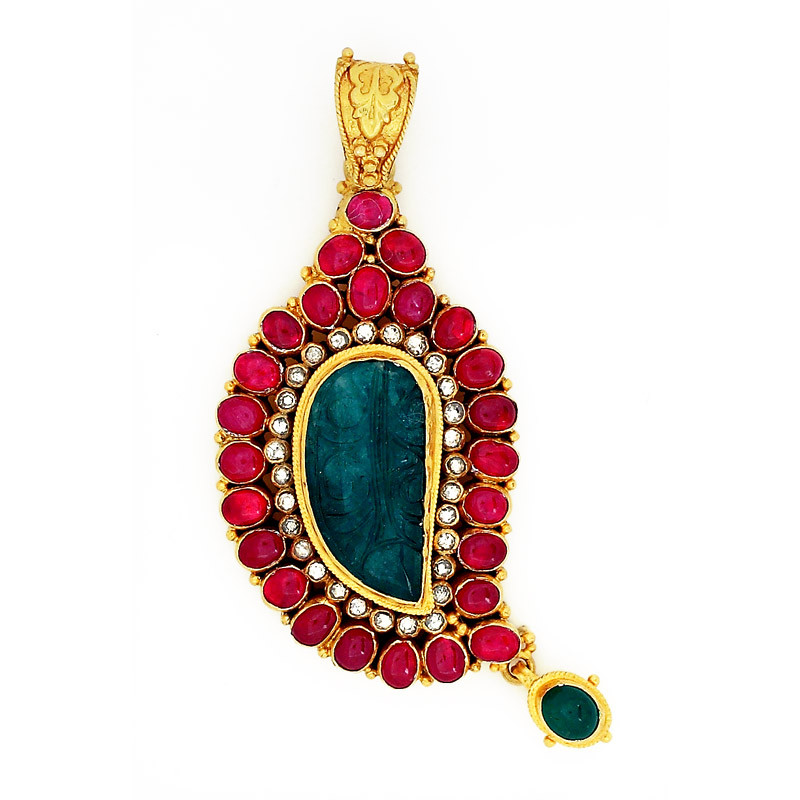 Mughal Inspired carved emerald center Pendant surrounded by Uncut Diamonds and Rubies